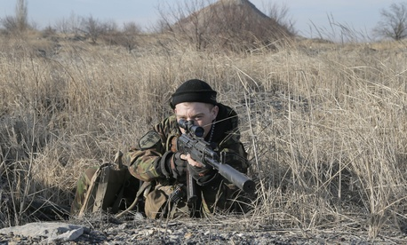A Ukrainian serviceman takes position at the front line outside Kurahovo, in the Donetsk region, Ukraine, Wednesday, March 11, 2015.