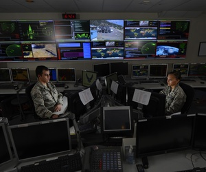 Two airmen work in the Global Strategic Warning and Space Surveillance System Center at Cheyenne Mountain Air Force Station, Colo., on Sept. 2, 2014.