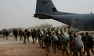 A multinational force of free fall parachutists board a Canadian C-130 for a jump wing exchange in Mao, Chad, Feb. 28, 2015, during Exercise Flintlock 2015.