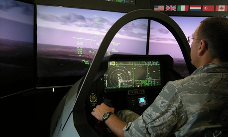 "The vice commander of the 88th Air Base Wing takes a ""ride"" in the cockpit of an F-35 Lightning II simulator."
