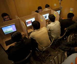 In this photo taken on March 7, 2012, people use the internet at a local cafe in Islamabad, Pakistan.