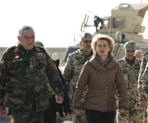 German defense minister Ursula von der Leyen walks with Afghan Maj. Gen. Zalmai Wesa during a visit to CAmp Shaheen, on Dec. 13, 2014.