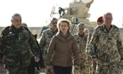German defense minister Ursula von der Leyen walks with Afghan Maj. Gen. Zalmai Wesa during a visit to CAmp Shaheen, on Dec. 13, 2014.