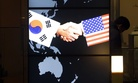 Seen here, the screen showing an image of a handshake by the U.S. and South Korean flags, on Jan. 14, 2015.