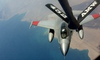 A KC-135 tanker from the Air Force Reserve's 336th Air Refueling Squadron refuels an Egyptian fighter aircraft during in-flight refueling training.
