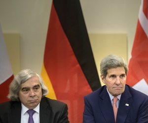 US Secretary of Energy, Ernest Moniz, left, and US Secretary of State, John Kerry wait for the start of a trilateral meeting at an hotel in Lausanne Saturday, March 28, 2015.