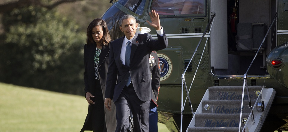 President Barack Obama waves as he walks across the South Lawn of the White House with first lady Michelle Obama in Washington, Monday, March 30, 2015.