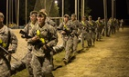 Soldiers cool down after a two-mile run with their assigned weapons, before participating in an obstacle course on Fort Benning, Ga., Feb. 7, 2015.