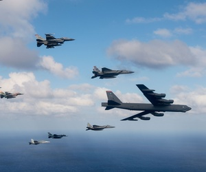 U.S. Air Force, Japan Air Self-Defense Force and Royal Australian Air Force aircraft fly in formation off the coast of Guam during Cope North 15, Feb. 17, 2015.