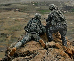 1st Lt. Jared Tomberlin (left) from the 4th Infantry Regiment, gets a first hand view of his new area of responsibility from his predecessor on top of a ridge near Forward Operation Base Lane in the Zabul Province of Afghanistan.