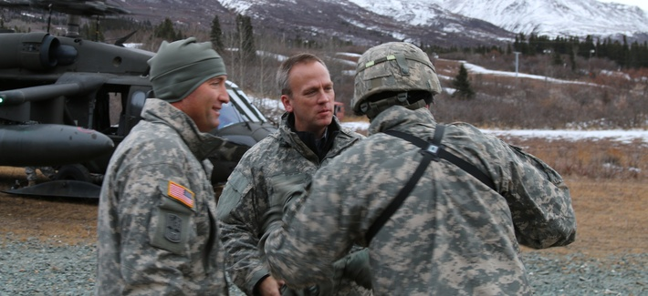 Under Secretary of the Army Brad Carson, along with Maj. Gen. Michael H. Shields, commanding general of U.S Army Alaska, arrive at Black Rapids Training Site, Nov. 18, 2014.
