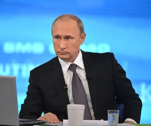 "Russian President Vladimir Putin listens during an annual call-in show on Russian television ""Conversation With Vladimir Putin"" in Moscow, Russia, Thursday, April 16, 2015."