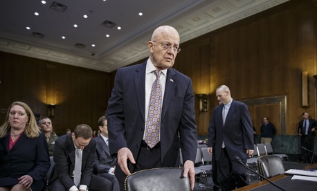 Director of National Intelligence James Clapper arrives on Capitol Hill in Washington, Thursday, Feb. 26, 2015, to testify before the Senate Armed Services Committee.