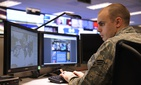 An airmen with the 24th Air Force works on cyber issues at Port San Antonio.