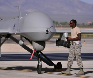 A dedicated crew chief prepares an MQ-1B remotely piloted aircraft for a training mission, May 13, 2013.