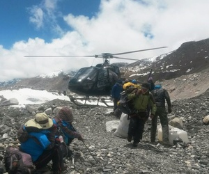 A rescue chopper lands carrying people from higher camps to Everest Base Camp, Nepal, Monday, April 27, 2015.