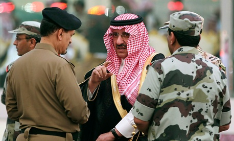 Prince Mohammed bin Nayef bin Abdul Aziz, Saudi Deputy Interior Minister at the time, speaks with Saudi officials while he attends a martial parade of Saudi armed forces outside Mecca in October 2012.