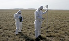 In this Sept. 15, 2008 file photo, experts take measurements during an exercise at the former nuclear test site of Semipalatinsk, northeastern Kazakhstan.