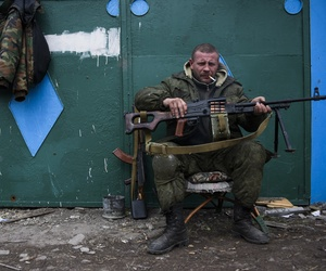 Ukrainian army soldiers perform a military exercise at a training ground outside Zhitomir, Ukraine, Friday, March 6, 2015.In this Thursday March 12, 2015 file photo, a pro-Russian rebel rests at the frontline in a village not far from Luhasnk.