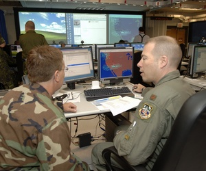 Airmen participate in a 2007 coalition nation demonstration inside a Hanscom facility known as the CEIF.