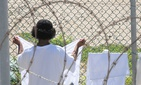 A detainee hangs his laundry in the recreation area of Camp Four at Joint Task Force Guantanamo in a 2010 photo.