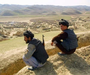 Afghan militiamen, Gen. Rashid Dostum-aligned fighters, are on guard on a hill over Karnai village, 80 kilometers (50 miles) south of Mazar-e- Sharif, Thursday, Jan. 31, 2002.