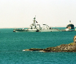 The crippled USS Cole is towed into deep water by Yemini tug boats from the port of Aden, Sunday Oct. 29, 2000.