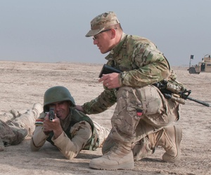 U.S. soldiers instruct Iraqi security forces on defensive tactics at Besmaya Range Complex, Iraq, on March 26.