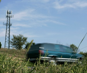 In this file photo taken Sept. 21, 2007, traffic passes a cellular tower along a stretch of Interstate 470 north of Lee's Summit, Mo.