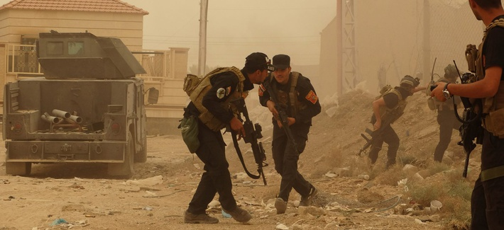 Security forces defend their headquarters against attacks by Islamic State extremists during sand storm in the eastern part of Ramadi, the capital of Anbar province, 115 kilometers (70 miles) west of Baghdad, Iraq, Thursday, May 14, 2015.