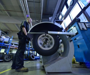An Airman checks the pressure on a tires at Ramstein Air Base, Germany, on Jan. 14, 2015.