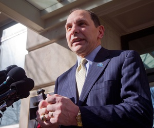 Veteran Affairs Secretary Robert A. McDonald speaks to reporters outside VA Headquarters in Washington, Feb. 24, 2015.