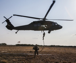 Special operations airmen repel from an Army National Guard Blackhawk helicopter while training in New Jersey.