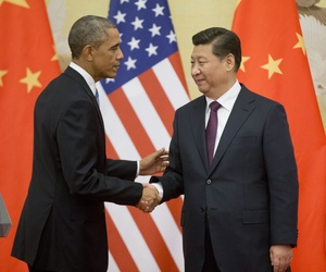 U.S. President Barack Obama, left, and Chinese President Xi Jinping shake hands following the conclusion of their joint news conference at the Great Hall of the People in Beijing, Wednesday, Nov. 12, 2014.