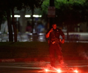An armed police officer stands guard at a parking lot near the Curtis Culwell Center where a provocative contest for cartoon depictions of the Prophet Muhammad was held May 3, 2015, in Garland, Texas.