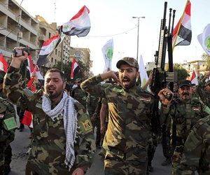 Iraqi Shiites from the Badr forces militia protest against the military intervention in Yemen, in Baghdad, Iraq, Tuesday, March 31, 2015.