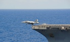 An F/A-18 Super Hornet assigned to the Black Knights of Fighter Attack Squadron (VFA) 154 is launched from the flight deck of the aircraft carrier USS Ronald Reagan (CVN 76).