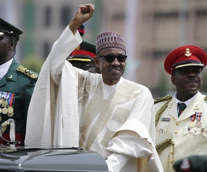 New Nigerian President, Muhammadu Buhari, salutes his supporters during his Inauguration in Abuja, Nigeria, Friday, May 29, 2015.