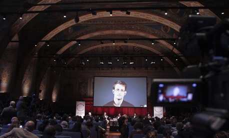 National Security Agency leaker Edward Snowden appears on a live video as he attends a International Journalism Festival panel via Skype, on April 17, 2015.
