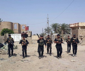 Iraqi anti-terrorism forces patrol in Ramadi, Iraq, Saturday, April 18, 2015.