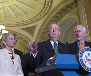 enate Majority Leader Mitch McConnell of Ky. , flanked by Sen. Shelley Moore Capito, R-W.Va., left, and Senate Majority Whip John Cornyn of Texas, speaks during a news conference on Capitol Hill on June 9, 2015.