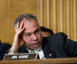 Sen. Tim Kaine, D-Va., center, with Sen. Edward J. Markey, D-Mass., at left, listen as Secretary of State Kerry appears before the Senate Foreign Relations Committee at the Capitol in Washington, Tuesday, April 8, 2014.