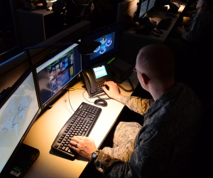 An airman at Port San Antonio goes over systems during an open house for the Air Force's cyber forces.