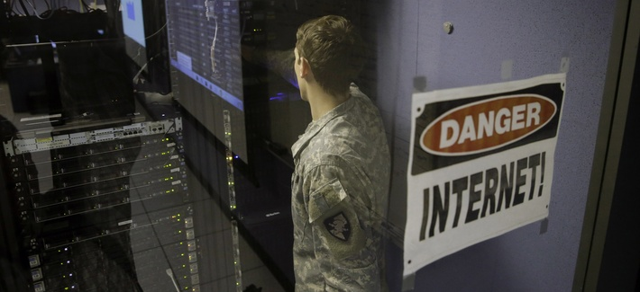 A United States Military Academy cadet checks computers at the Cyber Research Center at the United States Military Academy in West Point, N.Y., Wednesday, April 9, 2014.