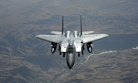 A U.S. Air Force F-15E Strike Eagle fighter aircraft flies over the skies of Afghanistan on July 30, 2011.