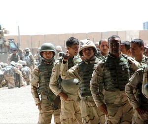Soldiers from the 76th Iraqi Infantry Brigade receive M16A2 rifles and infantry sets as part of the fielding of combat brigade sets supplied to Iraqi Security Forces May 25, 2015, at Camp Taji, Iraq,