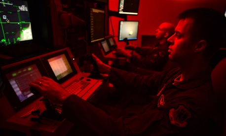 First Lt. Kyle, 91st Attack Squadron pilot, and Tech. Sgt. Jason, 91st ATKS sensor operator, fly a simulated training mission on an MQ-9 Reaper at Creech Air Force Base, Nev., May 8, 2014.