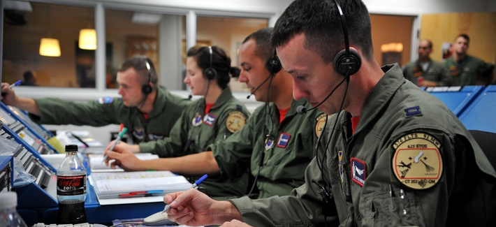 Members of the 576th Flight Test Squadron conduct pre-flight operations for a Minuteman III ICBM at Vandenberg Air Force Base, Calif. Pentagon officials are standing up a new facility to back up Vandenberg's Joint Space Operations Center.