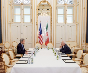 Secretary of State John Kerry negotiates a deal with Iranian foreign minister Javad Zarif.