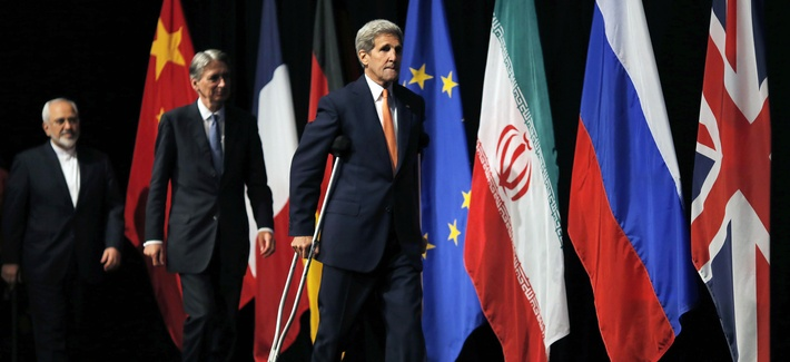 U.S. Secretary of State John Kerry, centre British Foreign Secretary Philip Hammond, centre and Iranian Foreign Minister Mohammad Javad Zarif arrive for a group picture at the Vienna International Center in Vienna, Austria, Tuesday, July 14, 2015.
